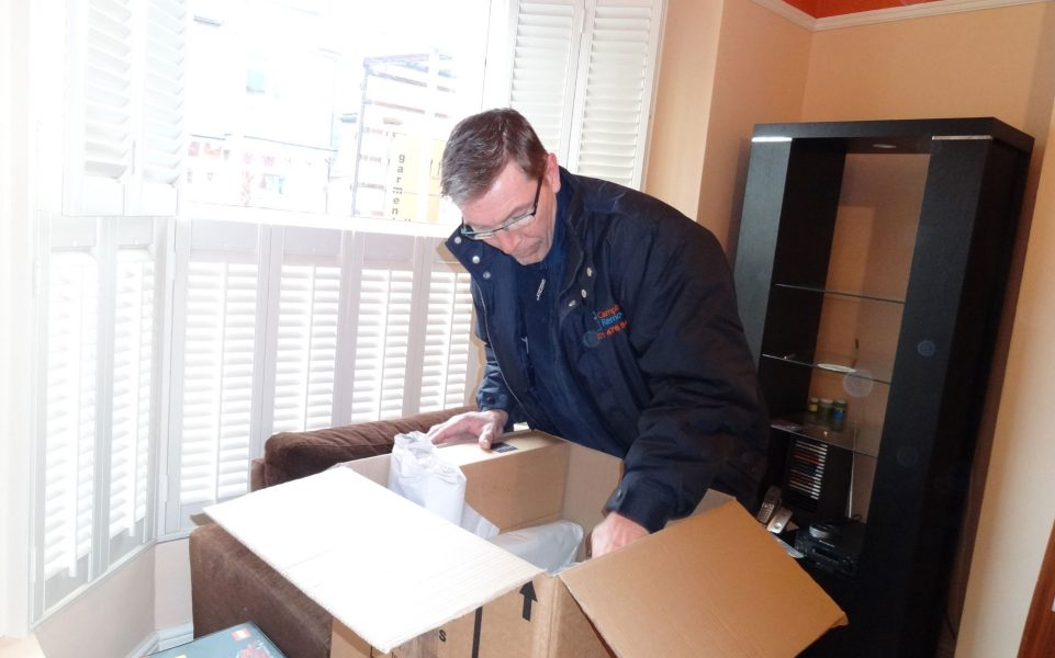 Campbell's staff member packing a living room