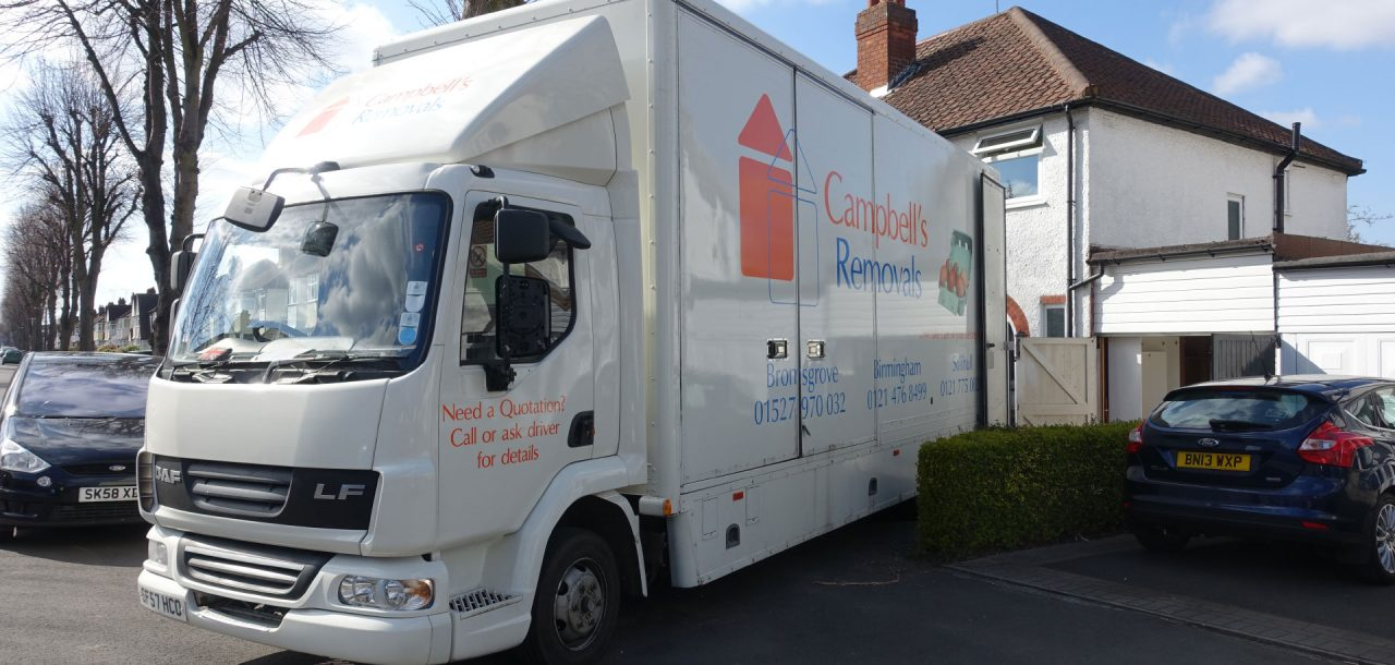 Bromsgrove Removals firm Campbell's lorry backed up to a residential property