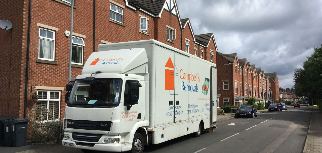 Bromsgrove Removals firm Campbell's lorry outside terraced houses