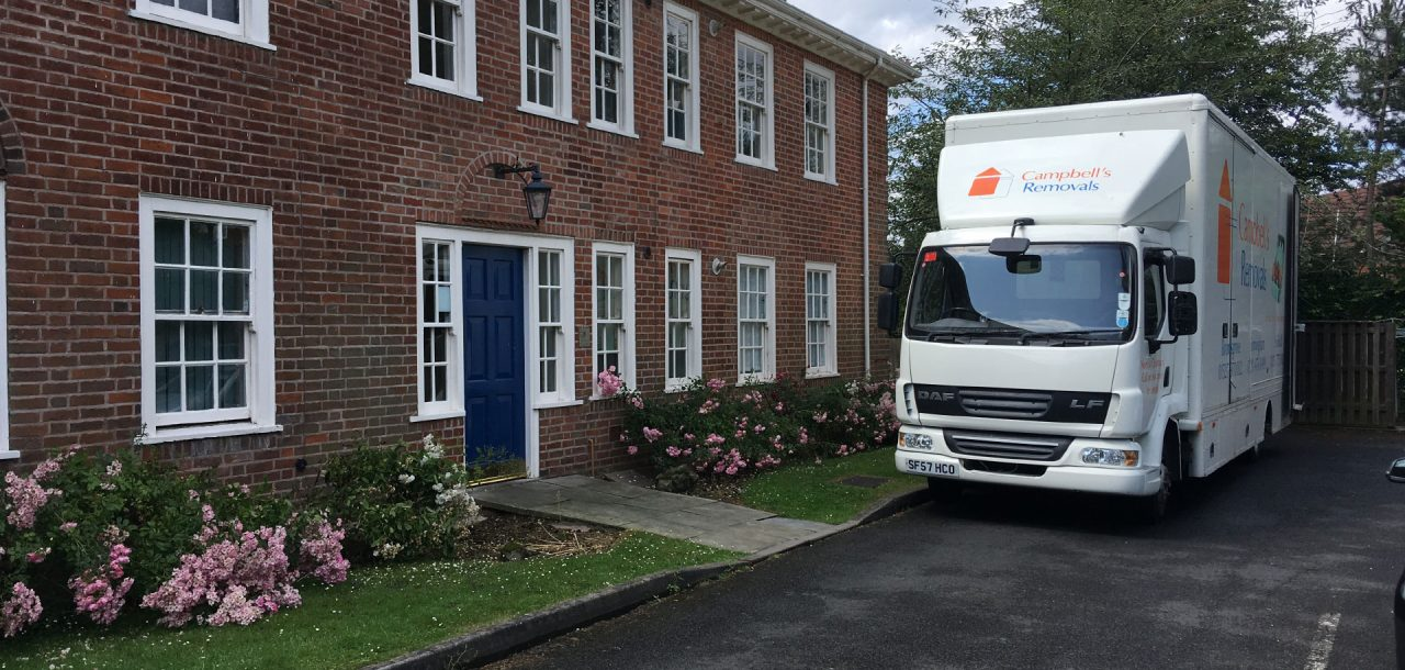 Bromsgrove removals firm Campbell's Removals lorry outside a large building
