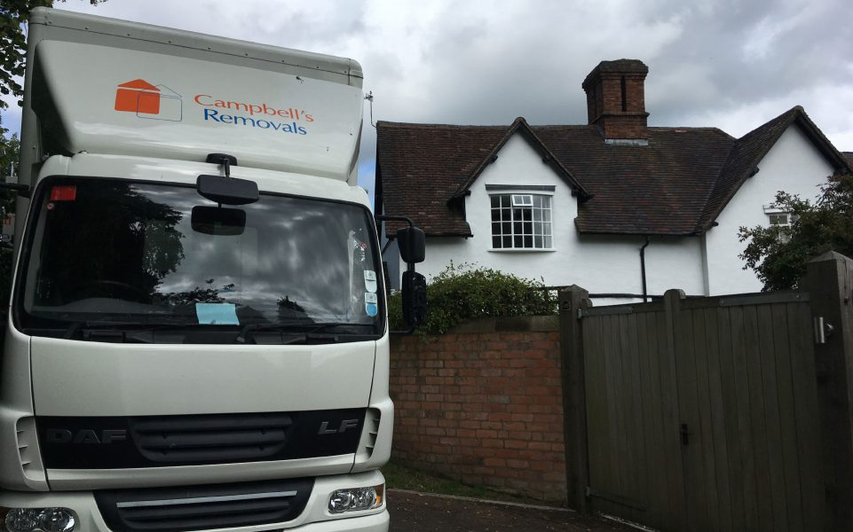 Bromsgrove removals firm Campbell's lorry outside a residential property