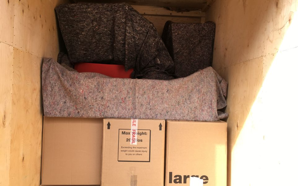Interior shot of a packed Campbell's Removals lorry